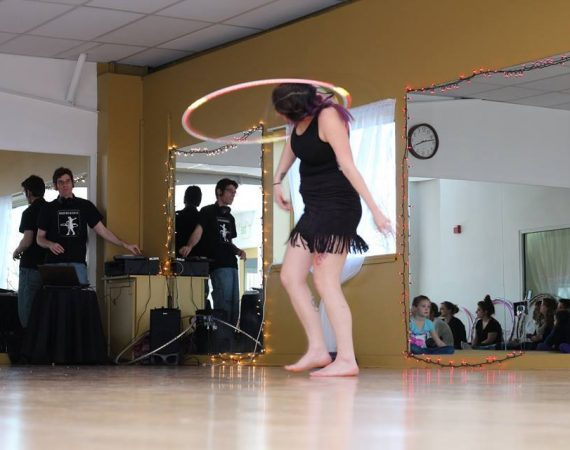 performing hula hoops